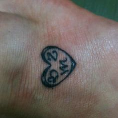My tattoo on my foot. First initials of my 3 children.