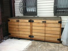 Enthralling Rubbermaid Outdoor Storage Cabinet with Shelves from Reclaimed Pine Wood Planks with Old World Door Pulls and Extra Heavy Duty Strap Hinge on Concrete Patio Tile Pavers also Wrought Iron Window Guards Trash Can Storage Outdoor, Outdoor Storage Units, Garbage Can Storage, Outside Storage Shed, Outdoor Trash Cans, Patio Storage, Storage Shed Plans, Storage Bins, Model