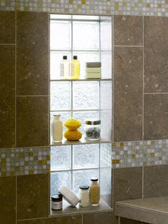 I like this idea to accommodate two things in one.  Window plus shower niche.