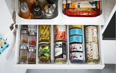 IKEA MA white kitchen pantry drawer can keep your cans, tins, and spices organized, while VARIERA white plastic baskets hold oils, tall bottles and more.