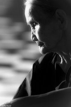 old woman, lit profile. hanoi, VN.