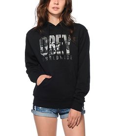 """Upgrade your streetwear collection with this soft fitted pullover hoodie featuring an """"Obey Worldwide"""" text graphic with NYC photo graphic fill."""