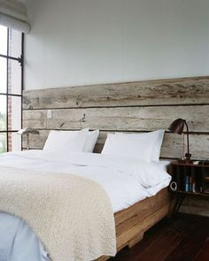 Wide barn boards the width of the wall for a headboard
