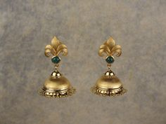 Fleur de Lis' Jhumki at Rs.66,500 online at Gehna.  Celebrating the warm glow of yellow gold, this pair of jhumkis has been styled with a hint of the rennaissance period in Indian jewellery.