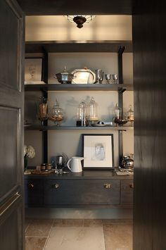 Surround your pantry with dark wood, attractive containers, and a gallery of your favourite art. Don't forget your most needed kitchen necessities. Butlers Pantry by karpaty cabinets