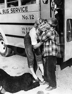 Doris Day with son Terry and their pet dog. Terry on his way to school, gives Mom a kiss on the cheek. 1950's