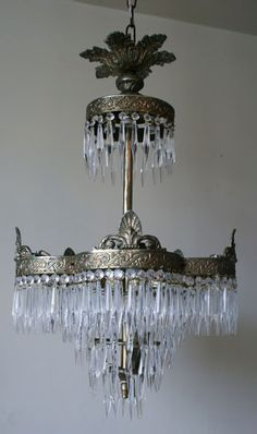 French Chandelier  A stunning French chandelier to make an impact made from gilt brass with hand cut crystal icicles  circa 1920s  70cm long x 42cm wide  £1,200.00
