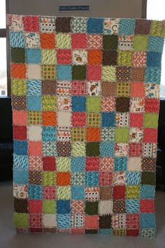 """crazy mom quilts: crazy mom quilts: one way to make a ragtime quilt...This quilt finishes at about 40"""" x 60""""...I'd consider that a large baby quilt or a child's lap quilt. The fabric is a fun line of flannels by Connecting Threads called Wild Ones. I used 27 fat quarters. I did not pre-wash my fabrics...First, press each of your fat quarters. From each FQ, cut out 12 5"""" squares.  Cut a total of 300 5"""" blocks."""