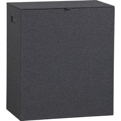 Felt Hamper: tailored to fit. Boutique hotel-style hamper is sturdy in a charcoal menswear wool felt blend with light grey double topstitching at the corner seams. Fabric lined with neat snap-out drawstring bag; open handles air it out.