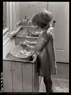 America's Backbone -  'Little girl carefully washing eggs.' - Eggs to be sold at Tri-County Farmers Co-Op Market. Reitz Farm, near Falls Creek,  Pennsylvania (1940)