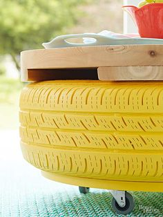 These storage coffee tables keep a few old tires out of landfills! Wash the tire thoroughly and let dry. Cut a plywood circle that's a few inches smaller than the tire. Prime the circle and the tire (inside, too) using an oil-base primer, then paint using latex outdoor paint. When dry, attach casters to the bottom of the circle and use construction adhesive to secure the tire on top. For the tabletop, cut a round piece of maple plywood or construct a top using cedar planks like we did.