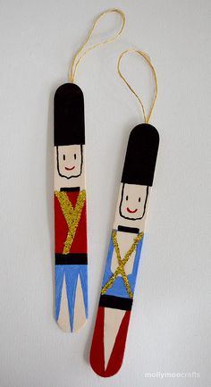 Add a little sparkle to your tree with these cute DIY popsicle stick nutcrackers // MollyMooCrafts.com