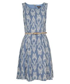This luxology dress features an ikat print in blue and ivory.