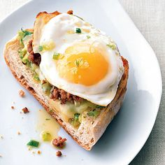 Fried Egg and Sausage Ciabatta Breakfast Pizzas Recipe  | Epicurious.com