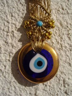 A Turkish nazar, an amulet believed to protect against the evil eye.  They are common in many countries (Turkey, Albania, Greece, Cyprus, Syria, Lebanon, Egypt, Armenia, Iran, Afghanistan, Iraq and Azerbaijan) and found hung in homes, offices and cars, for example.  by Marco Brown
