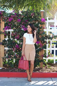 Camel pleated shift skirt, leopard pumps, white blouse, necklace and red leather Prada purse. // Click the following link to see outfit details and photos: http://www.stylishpetite.com/2013/10/camel-skirt-leopard-pumps-and-white.html