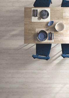 Edilcuoghi Legno Marino. #legno #marino #legnomarino #sea #living #contemporary #light #sun #wood #effettolegno #design #gres #edilcuoghi #white #chair #glass #wall #kitchen