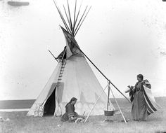 MOSES ON THE MESA Women working by Pine Tree tipi. Siksika. Early 1900s. Photo by Walter McClintock. Source - Yale Collection of Western Americana, Beinecke Rare Book and Manuscript Library.