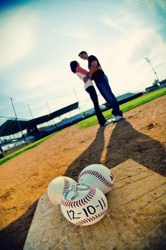 Save the Date photo idea- couple standing on baseball field in the background - three baseballs in a triangle the front baseball has the date on it and the ring on top of it