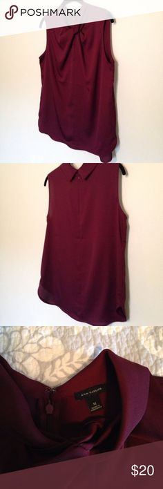 """NWOT Ann Taylor twist neck blouse Ann Taylor maroon polyester shell blouse. 20"""" armpit to armpit. 24"""" shoulder to hem (slightly longer in back). Closes with back zip and hook & eye. Ann Taylor Tops Blouses"""
