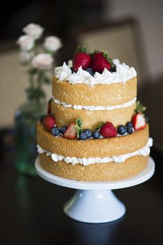 "Love the ""naked"" wedding cake look. This would also make a great cake for a red, white, and blue themed wedding or event. Photo by Trish Barker Photography."
