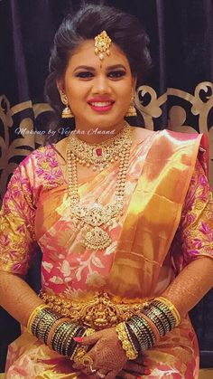 Varshitha is all smiles after her makeover for her reception. Makeup and hairstyle by Vejetha for Swank Studio. Pink lips. South Indian bride. Eye makeup. Bridal jewelry. Bridal hair. Silk sari. Bridal Saree Blouse Design. Indian Bridal Makeup. Indian Bride. Gold Jewellery. Statement Blouse. Tamil bride. Telugu bride. Kannada bride. Hindu bride. Malayalee bride. Find us at https://www.facebook.com/SwankStudioBangalore