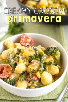 Creamy gnocchi primavera - a super simple vegetarian dinner! WIth heaps of colourful veggies and a cheesy, creamy sauce. Irresistible!