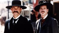 Tombstone bro-staches, Kurt Russel as Wyatt Earp, and Val Kilmer as sexy as Doc Holliday