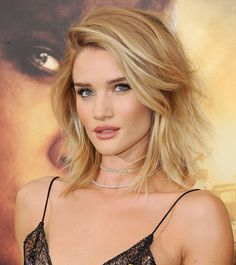Rosie Huntington-Whiteley's tousled lob completes a stunning evening look.