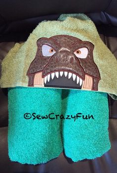 A personal favorite from my Etsy shop https://www.etsy.com/listing/289156985/t-rex-hooded-bathpoolbeach-towel
