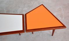 "1960s  Tripod Coffee Table and End or Side Table Set  Gorgeous Solid Teak Wood Frames   with Inset White and Soft Orange Colored Laminate Tops  Solid Wood Tapered Pencil Legs  Sleek Scandinavian Styling with Amorphic, Geometrically Shaped Designs  Can be Used Separately or Together  Coffee Table (White) : 46""........... x ........... 18.5""........... x .......... 16.5"" H  Side Table (Orange) : 20""........... x ........... 18.5""........... x ........... 16.5"" H  In Pristine Refinished…"