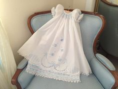 Your babys special day will be even more special with this beautiful heirloom quality dress, featuring a blue bishop-style smocked neckline,