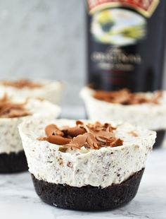 These Boozy Baileys Mini Cheesecakes are so easy to make and are the perfect festive party food, they'll be gone in no time! www.insidetherustickitchen.com