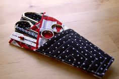 The inspiration for my quilted scissors holder came directly from Vicky's Fabric Creations Folded Fabric Scissor Holder Tutorial . Vicky'...