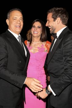 Pin for Later: All the Times Sandra Bullock Lit Up a Room  Sandra shared a laugh with Tom Hanks and Bradley Cooper at the Palm Springs Film Festival in January 2014.