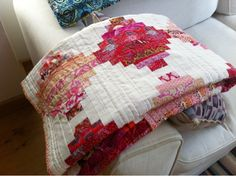 """Fantastic Courthouse Steps Birthday quilt made by Elsy from Filling the Space """"I used Aurifil thread for the first time and I'm completely won over. Really good in the machine and using for the hand stitching. No knots or breaking.""""    To see more visit  http://elsy-fillingthespace.blogspot.com/2013/04/finished-and-gone-court-house-steps.html"""