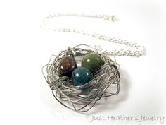 SOLD! www.etsy.com/shop/JustHeathersJewelry - Bird's nest necklace- wire wrapped- blue, green, brown beads and stones- birdnest, robins egg nest