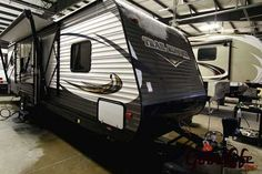 2016 New Heartland Trail Runner 27RKS Travel Trailer in Iowa IA.Recreational Vehicle, rv, 2016 Heartland Trail Runner , Comfortable rear kitchen trailer loaded with power jacks, awning, enclosed underbelly and a rear bike rack. For sale at Good Life RV in Iowa., Furniture: 2 Chairs, Corner Shower, Designer light over dinette, Fabric covered box valances, Fabric covered valance legs, Full Extension Drawer Glides w/Ball Bearings, Jacknife Sofa, Medicine cabinet with mirror, Multi-purpose…