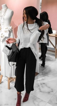 #winter #outfits woman wearing white sweatshirt, black straight-cut pants, and pair of brown patent leather stiletto booties