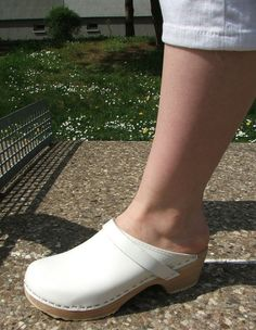 Bare foot in an immaculate clog.