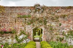 The artists, writers and intellectuals of the charmed Bloomsbury Group often retreated to the Sussex and Kent regions, where quite a few were avid gardeners. Sissinghurst Garden, Vita Sackville West, Bloomsbury Group, Moon Garden, Garden Path, British Countryside, Beautiful Buildings, Beautiful Places, Evergreen