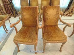 Lot 565 - A set of 14 x carved and upholstered arm chairs in a gold draylon fabric, continental design of