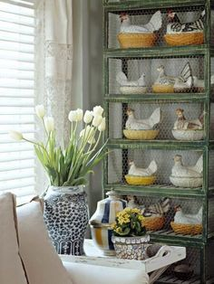 """I don't usually do """"whimsy,"""" but I really love these porcelain hens on nests behind chicken wire in antique coops....thank you atticmag. by Robins Nest Eggs"""