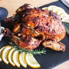 A spicy, citrus whole roasted chicken in a dutch oven.
