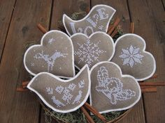 Cross stitch and felt Ornaments for sale  via Etsy.