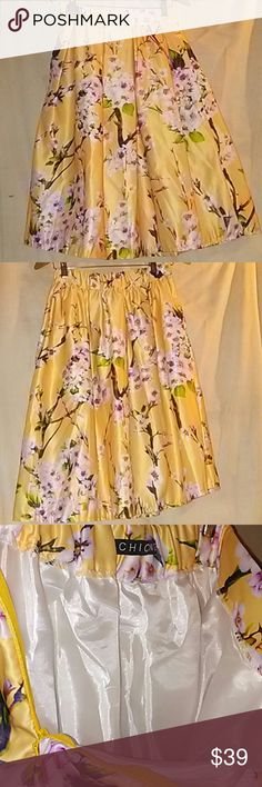 """FLORAL NWOT FLARE SKIRT YELLOWS ORCHIDS YELLOWS/ GREENS/BROWNS/ WHITES    FULL SKIRT EXCELLENT CONDITION   Length: 25""""  Waist: 13""""  Bottom width: 30"""" CHICING Skirts A-Line or Full"""