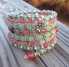 A 7 coil memory wire wrap bracelet featuring smooth 6mm green aventurine gemstones, 8mm faceted multi colored agates, 4mm smooth pink jade