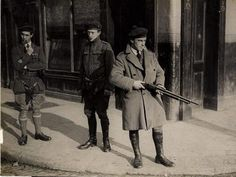 Black and Tans with a shotgun