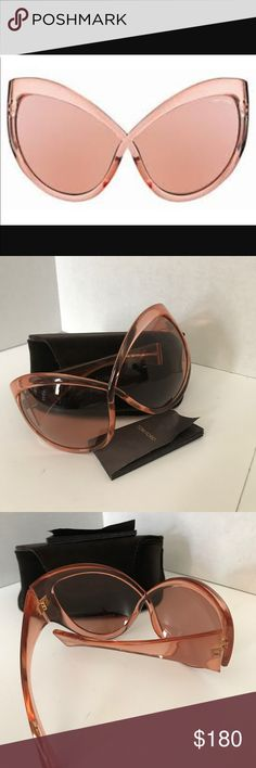 Tom Ford Large Daphne Cateye Sunglasses Authentic Tom Ford very stylish over exaggerated cat eye sunglasses. They are in great condition no scratches very well taken care of. They are a light brown close to peachy color. Super cute. Model number is FT0219. 100% Authentic! Tom Ford Accessories Sunglasses