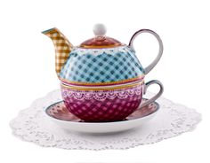Love the bright colors for the tea set.